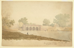 A four-arched bridge spanning a narrow river, Sirhind, men fishing and washing clothes.  To the right are ruins of an earlier bridge.  An army officer sits sketching on the river bank